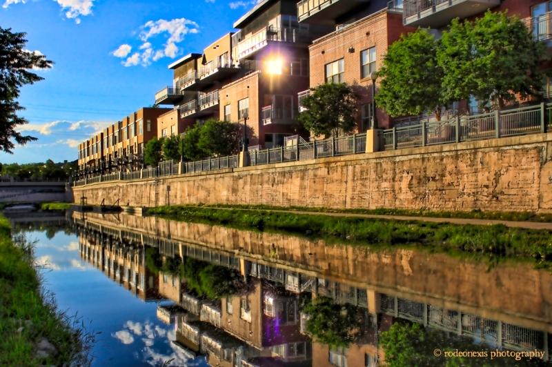 Condos reflect off Cherry Creek, Denver