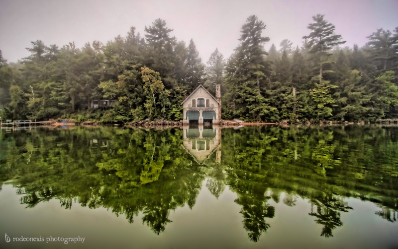 Denton's boathouse in a blanket of fog and mist. Newfound Lake, NH