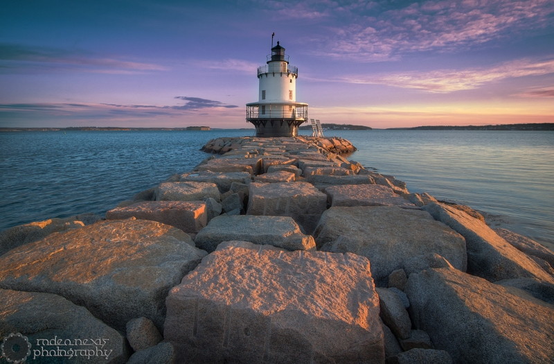 Spring Point Ledge Lighthouse, and its breakwater extend into Portland Harbor.