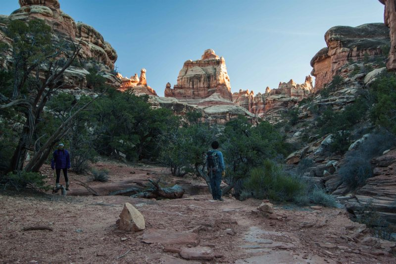 Hiking south along the Druid Arch Trail during evening light
