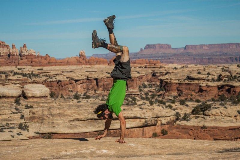 Derek busts a handstand near the canyon rim.