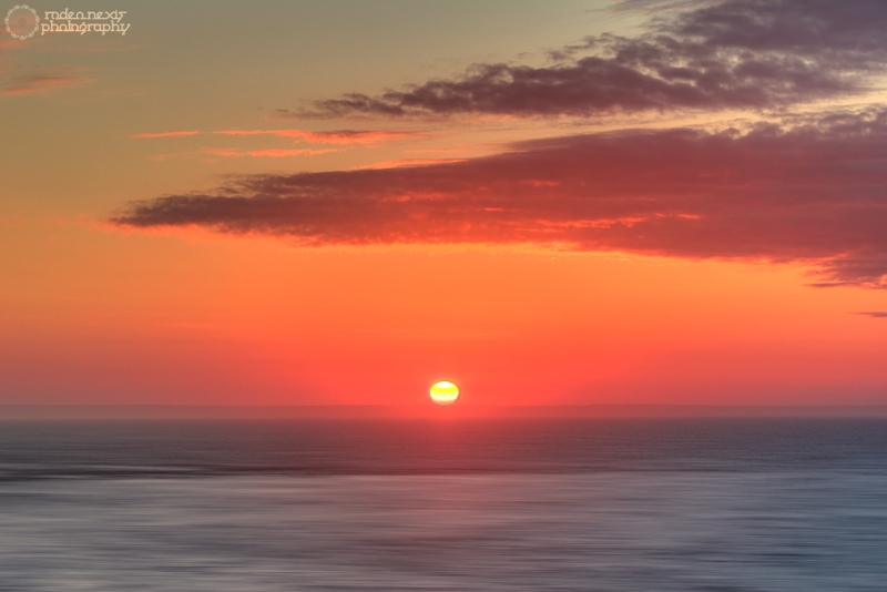 The sun rising over Grand Manan Island (CAN) and the Bay of Fundy